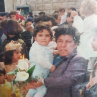 Fadi as a baby with his mother, Hiam Chalouhy, at a Palm Sunday celebration in Lebanon. His father, who left them a year after Fadi was born, never registered his birth.