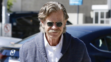 Actor William H. Macy, who was not charged, arrives at the federal courthouse in Los Angeles on Tuesday.