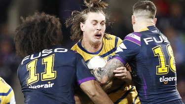 Defensive pressure: Scott, right, joins Felise Kaufusi in the tackle of Shaun Lane of the Eels in the semi-final at AAMI Park.