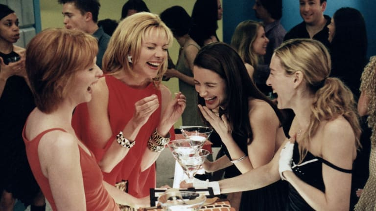 Cattrall, the second left, with the SATC team.