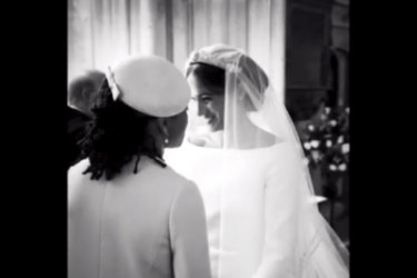 Meghan holding hands with her mother, Doria Ragland.