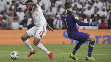United Arab Emirates' forward Ali Mabkhout dribbles past Australian goalkeeper Mat Ryan to score an easy goal.