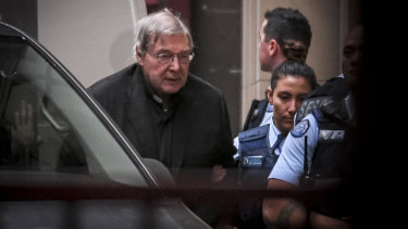 George Pell arrives at the Supreme Court in June for the last day of his appeal hearing.