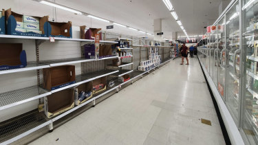 Empty shelves at Port Melbourne Coles once contained toilet paper.