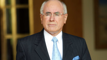 John Howard has urged Dave Sharma to stay in the race.