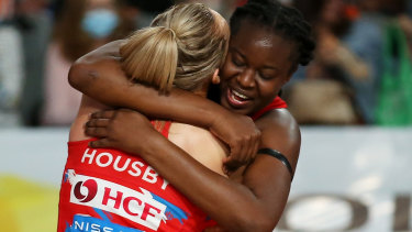 Sam Wallace embraces shooting partner Helen Housby after the Swifts' semi-final victory over West Coast.