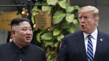 US President Donald Trump and North Korean leader Kim Jong-un take a walk after their first meeting.