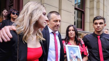 The family of young mother of two, Katie Haley, who was bashed to death with a barbell in her home by partner Shane Robertson, stand outside Melbourne's Supreme Court  after his sentencing on Thursday.
