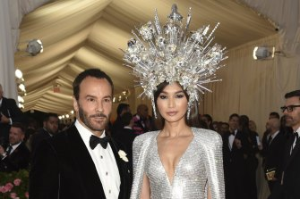 """Tom Ford, left, and Gemma Chan attend The Metropolitan Museum of Art's Costume Institute benefit gala celebrating the opening of the """"Camp: Notes on Fashion"""" exhibition on Monday, May 6, 2019, in New York."""