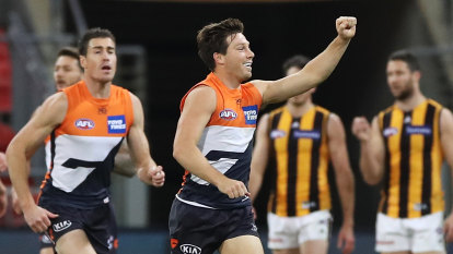 Giants give hub-bound Hawks a rough welcome to Sydney