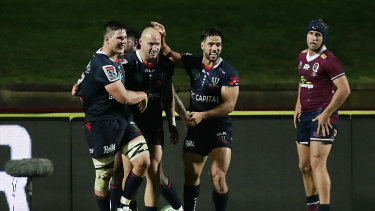 Rebels centre Billy Meakes scores a try against the Reds in Super Rugby AU.
