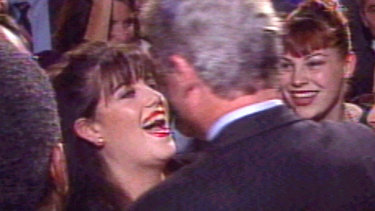 President Bill Clinton meets Monica Lewinsky at a fundraiser event in 1996.