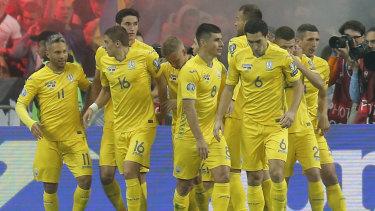 Ukraine's players celebrate a goal.