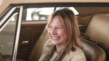 General Motors CEO Mary Barra sits in the first Chevrolet Camaro ever built at a Camaro Museum in Detroit.