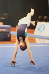 A young Ramm performing a floor routine.