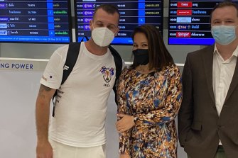 Luke Cook at Bangkok airport with wifeKanyarat Wechapitak. He arrived in Sydney on Sunday after being cleared of drug trafficking, for which he had been sentenced to death.