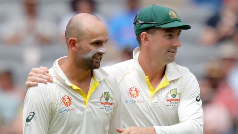 Chief destroyer: Nathan Lyon is hugged by Shaun Marsh after dismissing Rishabh Pant.