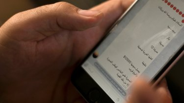 An activist looks at an Islamic State group marketplace on the encrypted app Telegram in 2016.