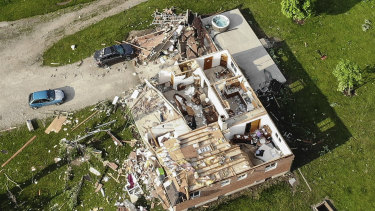 Storm damaged homes remain after a tornado passed through the area the previous evening.