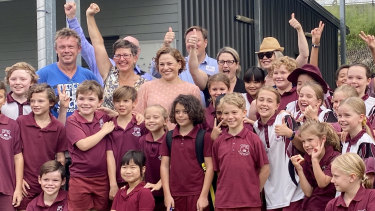 Buranda State School students, teachers, parents, Greens candidate Sally Dillon and South Brisbane MP Jackie Trad celebrate the decision on Thursday.