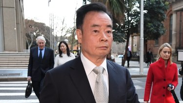Businessman Chau Chak Wing, who is suing Fairfax Media for defamation, leaves the NSW Federal Court.