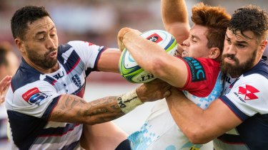 Quite the journey: Andrew Kellaway is picked up by the Rebels – his new side – while playing with the Waratahs.