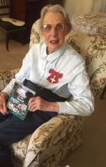 Alison Todd on her 88th birthday with a copy of her life story.