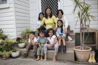 Faith Labaro (centre) with her children (bottom from left) Daniel, 4, Gabriel, 3, Nyomi, 7, and (top row) Stephanie, 12, Jazzmin, 9, and Samantha, 16.