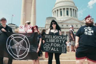 Meet the outre circus in Hail Satan.
