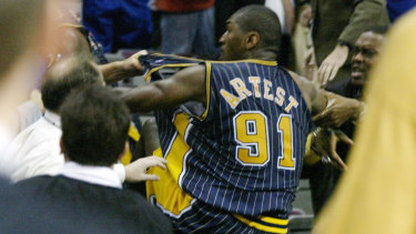Artest clashes with fans.