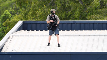 A SERT officer on the hotel roof during the stand-off.