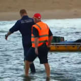 Two people have drowned at one man remains missing after a group of six got into trouble in the water at Moonee Beach, in Coffs Harbour.