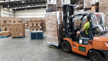 Boxes full of new plastic bottles for hand sanitiser manufactured by Pro-Pac Packaging in Melbourne.