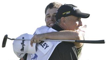 Aaron Baddeley hugs caddie Pete Bender after winning the FBR Open in 2007.