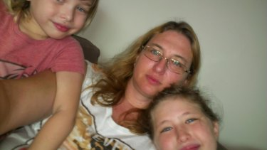 Taylor is unrecognisable after going hungry in a Cambodian prison. Her with children Kahlyla, left, and Archer, right.