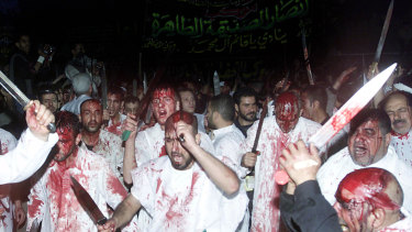 Shiite Muslims conduct the rites of Ashura in Sayyida Zeinab, south of Damascus, in 2004. Such displays have become more visible with Iran's increased influence.