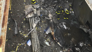 The crash that killed the pilot and occurred near Times Square and Trump Tower shook the 229-metre AXA Equitable building, sparked a fire and forced office workers to flee.