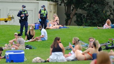 Police patrolled St Kilda as people enjoyed the warm weather.