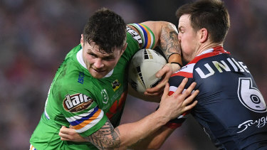 John Bateman tries to shrug off Luke Keary during last year's grand final.