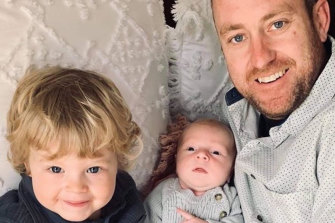 Jarrod Fox pictured with his two young sons, Archer, 2, and Jasper, five weeks.