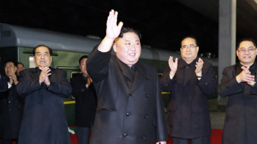 North Korean leader Kim Jong-un waves at an undisclosed train station in North Korea on Wednesday, before leaving for Russia.