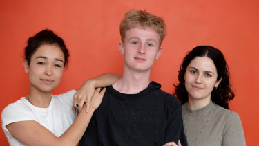 Gus Skattebol-James (centre), with Maya Newell (left) and Charlotte Mars (right), the makers of the film Gayby Baby, in which he starred.