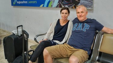 Scherie and John Todd, from Northbridge, Sydney wait at Lombok Airport on Tuesday.