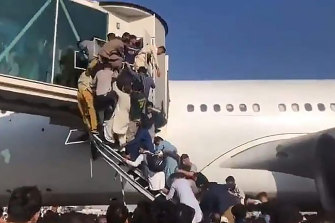 There were desperate scenes at Kabul airport as Afghans tried to board planes after the Taliban took control of the city.