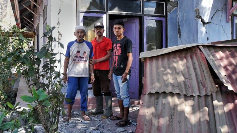 From left: Kurniadi, Hasbi Haer and Ahmad Munadi outside their damaged house in Sembalun Bumbung.