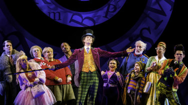 Paul Slade Smith as Willy Wonka with the lead cast of Charlie and the Chocolate Factory - The New Musical.