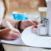 Client reading and signing legal document at a meeting in a cafe Generic legal paperwork image.