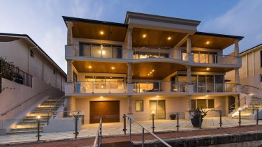 Perth billionaire Angela Bennett has three properties on the same street in Wannanup overlooking a canal.