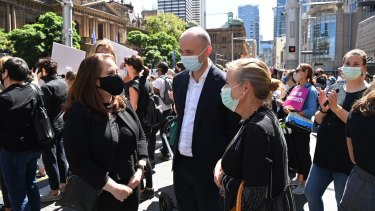 Matt Kean NSW Environment minister and Liberal MP Felicity Wilson attend the Women's March 4 Justice protest in Sydney.