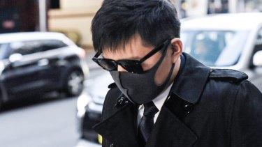 Longwei Xu leaves court on Wednesday.